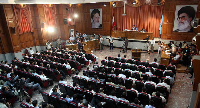 A general view of a courtroom shows susp