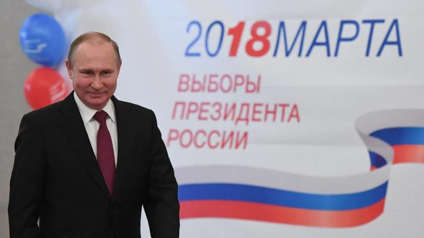 Putin wins russian elections by massive landslide